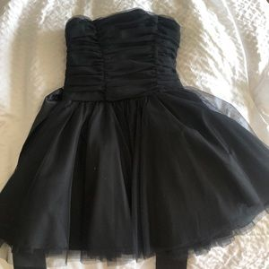 Adorable tulle dress with a tie around bow